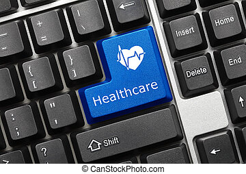 Conceptual keyboard - Healthcare blue key - Close-up view on...