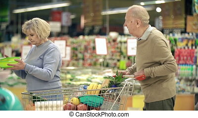 Shopping Together - Close up of man and woman choosing a...