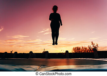 Silhouette Of Beautiful Plus Size Young Woman Girl Jumping...