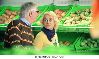 Picking Pears - Couple selecting pears in the mall