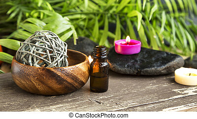 Spa Essential Oil with Scent Candles on Wellness Background...