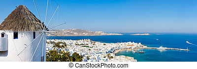 Mykonos island - White greek windmill overlooking...