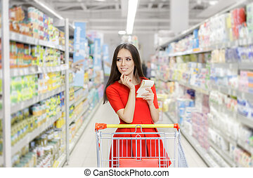 Woman whit Shopping List - Young girl in a market store with...