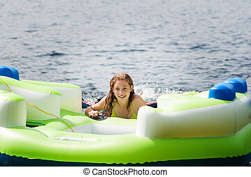 teen on an inflatable raft - teenage girl on an inflatable...