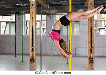Woman dancing on the pole