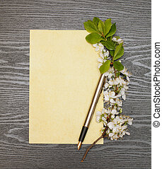 cherry blossoms and paper - cherry blossoms, sheet of paper...