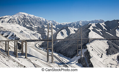 Huge and beautiful road bridge in snowy mountains