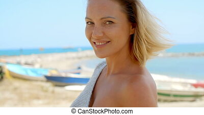 Portrait of Blond Woman Standing near Ocean - Head and...