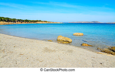 Conca Verde shore with rocks - Conca Verde shoreline on a...