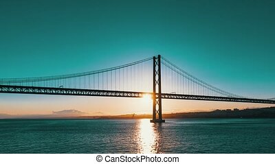 Sunset on the 25 de Abril Bridge in Lisbon