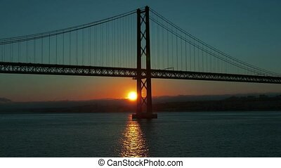 Sunset on the 25 de Abril Bridge in Lisbon, timelapse