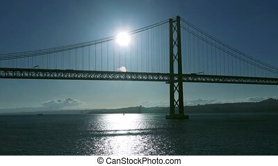Sunset on the 25 de Abril Bridge in Lisbon, Portugal