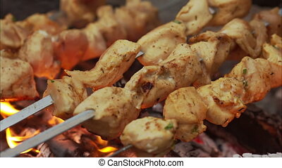 beef kababs on the grill closeup - Juicy slices of meat with...