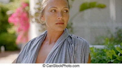 Woman in Grey Robe Outdoors Looking at Camera - Head and...