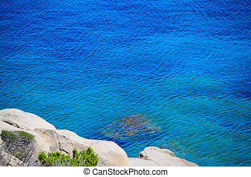 white rocks and blue sea in Capo Testa, Sardinia