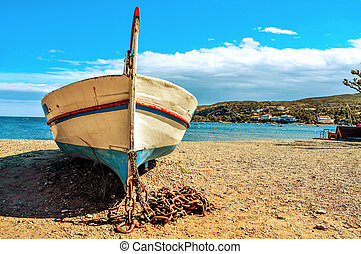 old fishing boat stranded on the beach in Cadaques, Costa Brava, Spain