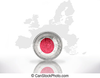 euro coin with japanese flag on the european union map...