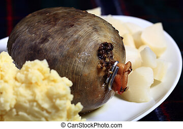 Haggis on a plate - View of a haggis on a plate with mashed...