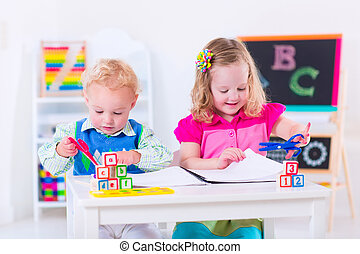 Kids at preschool painting - Kids at preschool Two children...