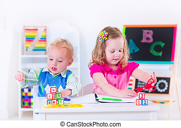 Kids at preschool painting - Kids at preschool. Two children...