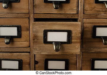 Opened Card Index Drawer - An old style wooden cabinet of...