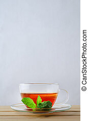 Lemon Tea in Glass Cup with Mint Sprig