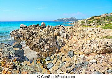 yellow rocks in Santa Reparata shore - rocks in Santa...