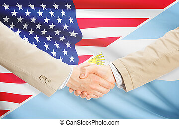 Businessmen handshake - United States and Argentina -...