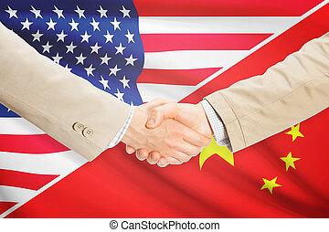 Businessmen handshake - United States and China -...