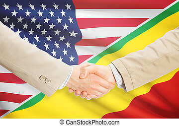 Businessmen handshake - United States and Congo-Brazzaville...