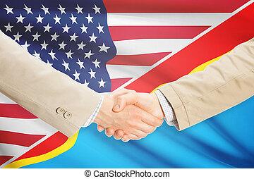 Businessmen handshake - United States and Congo-Kinshasa -...