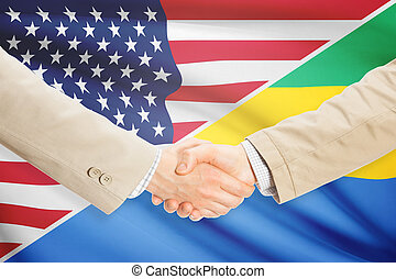 Businessmen handshake - United States and Gabon -...
