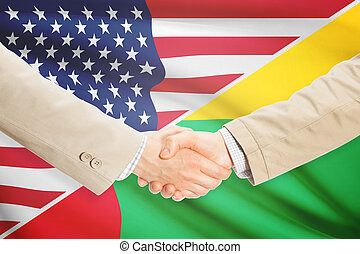 Businessmen handshake - United States and Guinea-Bissau -...