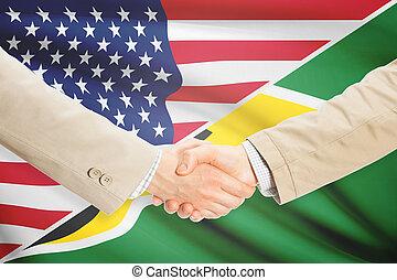 Businessmen handshake - United States and Guyana -...