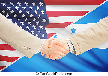 Businessmen handshake - United States and Honduras -...