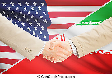Businessmen handshake - United States and Iran - Businessmen...