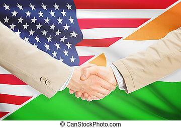 Businessmen handshake - United States and Niger -...