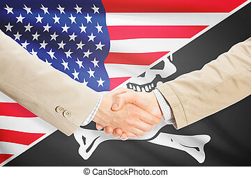Businessmen handshake - United States and Jolly Roger -...
