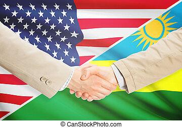 Businessmen handshake - United States and Rwanda -...