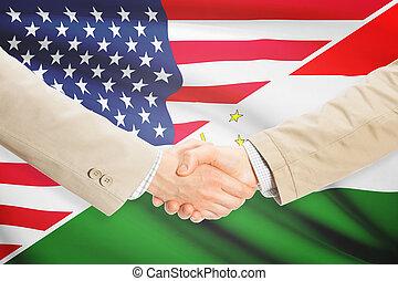 Businessmen handshake - United States and Tajikistan -...