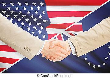 Businessmen handshake - United States and Cook Islands -...