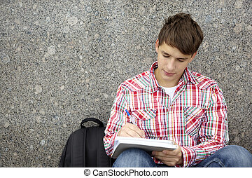 student - college series, teen writing , selective focus on...