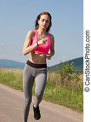 Fit and agile - Fit and agile young brunette woman running...