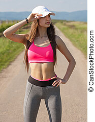 Fit and agile. - Fit and agile young brunette woman running...