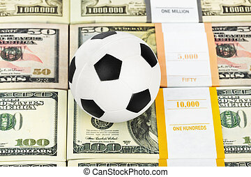 Money and soccer ball - sport and business background