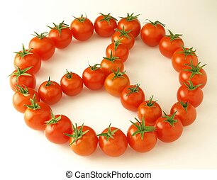peace symbol, made with tomatoes on white background