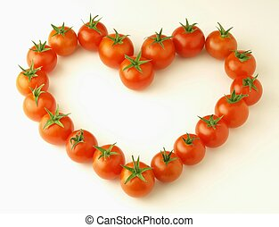 heart made with tomatoes on white background