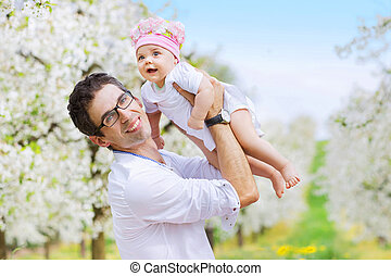 Cheerful father holding his beloved child - Cheerful man...