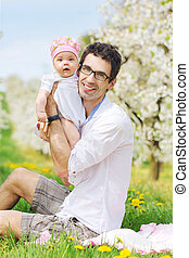 Portrait of a handsome man with his lovely daughter
