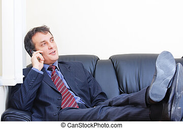 Relaxed businessman on phone